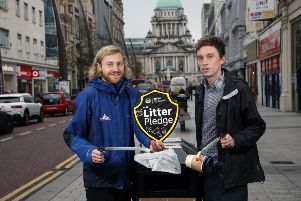 Chair of Belfast City Council's People and Communities Committee, Councillor Michael Collins (right) and Niall Burke, Belfast City Centre Management Business Liaison Officer.