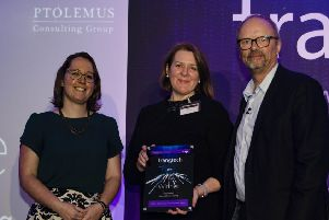 Irene McAleese, co-founder of See.Sense (middle), collects award.