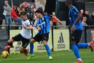 Charlie Pattison, left, in action for Kings Langley against Stourbridge earlier this season. (File picture by Chris Riddell).