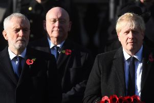 Labour party leader Jeremy Corbyn (left) and Prime Minister Boris Johnson during the Remembrance Sunday service at the Cenotaph memorial in Whitehall, central London