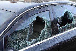 Police are investigating an attack on a property in north Belfast. The front window of a house in Etna Drive was smashed, and the windows of a car parked in the driveway were damaged