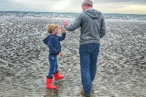 Jonny McCambridge with his son James on Tyrella Beach