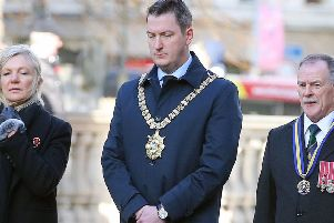 John Finucane, seen above on Remembrance Day 2019, is more plausible than Sinn F�in's old guard, but if elected will use his position to attack the state on legacy and assail British sovereignty. ''Picture by Jonathan Porter/PressEye