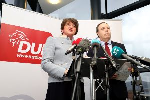 DUP leader Arlene Foster and deputy leader Nigel Dodds at the launch of their policy plan in the SSE Arena in Belfast