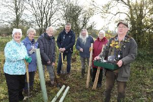 Twywell Hills and Dales, tree planting in memory of botanist Jack Laundon, member of the Kettering & District Natural History Society.L-R: Susan Carter, Mrs Aida Freville, Mr Nick Freville, Charles Langtree (The Land Trust), Roger Warren, Eileen Burley, Geoff Miles.