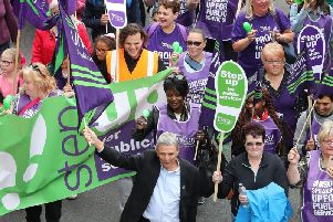 File photo dated 12/05/18 of General secretary of Unison Dave Prentis (front centre) during a TUC rally in central London. The first wave of planned industrial action by health and social care workers is set to start on Monday.