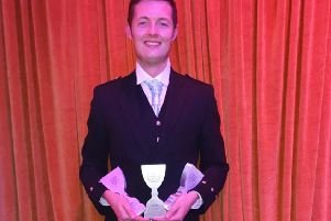 Gary McInyre, from Stewart Travel, with the awards.