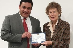 Kate Hoey MP, right, is one of the three MPs to get an award from Jonathan Ganesh of the the Docklands Victims' Association for her work for victims of terrorism