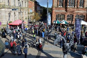 Pedestrianised.... The Sauruses entertain the crowds at the recent Heart of Samhain celebrations, in Guildhall Square, on Saturday afternoon last. DER4319GS - 089