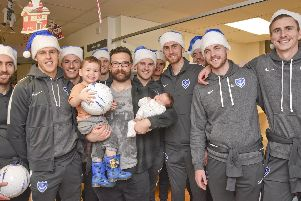 Pompey players and staff on their annual Christmas visit to patients at Queen Alexandra Hospital