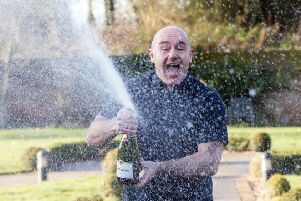 Terry Falgate celebrating his win on the UK EuroMillions Millionaire Maker at The Garden Room, Coltishall, Norfolk