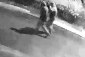 Police want to speak to the two people captured in this CCTV image