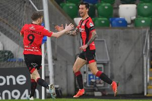 Declan Caddell celebrates after breaking the deadlock in Crusader's favour against Linfield.