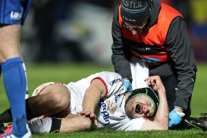 Ulster's Angus Curtis down injured' during the game against Leinster