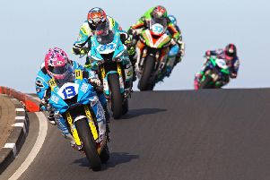 Lee Johnston leads Alastair Seeley and James Hillier in the Thursday evening Supersport race at the North West 200.