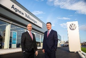 Agnew Volkswagen Franchise Director Brian Robinson and Sales Director Gerry Mulholland unveils �2 million Boucher Road retail investment
