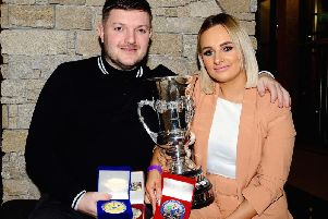 Melissa Kennedy received the Walter Rusk Memorial Cup for most improved road racer in 2019. Melissa is pictured with finace Gary Dunlop, who won the Moto3 Championship last year. Picture: Maurice Montgomery.