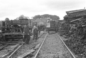 Workmen ripping up the railway line. Picture: Downpatrick & County Down Railway