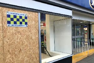 The new security cameras visible behind the front window of Melton's Boots store, which has been targeted by raiders three times in a month EMN-200114-170308001