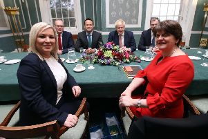 "Deputy First Minister Michelle O'Neill and First Minister Arlene Foster with Irish and UK leaders at Stormont on Monday. ""Where did 'not feeding the crocodile' go? Or no Irish language act 'on my watch'?"""