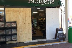 The damage to the shop front.