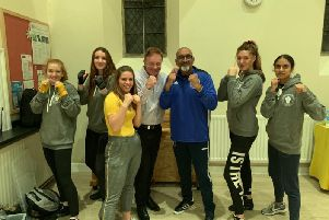 Leamington Community Boxing Club coaches Olivia, Phoebe, Emma, Sian and Priya with Colin Walker of Safeline and Babs head coach Babs Kandola.