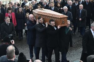 Seamus Mallon is carried to his final resting place in Co. Armagh on Monday. (Photo: Pacemaker)