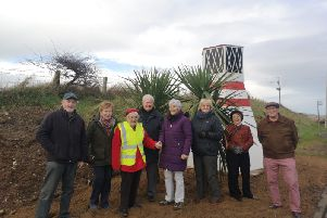 Volunteers from Brighter Whitehead are delighted with the new lighthouse.