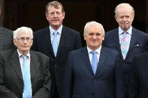 Lord Empey, back right, stood in for a while for David Trimble, back left, as acting first minister alongside deputy first minister Seamus Mallon, front left. Also pictured, Bertie Ahern, Taoiseach at time of the 1998 Belfast Agreement. All four are pictured in April 2018 at Queen's University in Belfast on the 20th anniversary of the accord. Photo: Brian Lawless/PA Wire