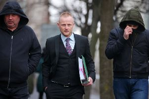 Prominent loyalist Jamie Bryson arriving at court this morning, flanked by supporters