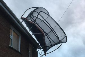 Trampoline blows on top of a roof - PSNI Facebook