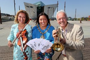 BBC Proms in the Park presenters Claire McCollum and Noel Thompson join forces with Lord Mayor of Belfast, Councillor Deirdre Hargey to announce this year's event, which takes place at the Titanic Slipways in Belfast on Saturday, September 8.