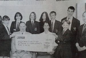 Ballyclare Secondary School pupils present a cheque for �2,622 to Alec Scott of the Ballyclare branch of the British Diabetic Association and Hilary Tennent of the Royal Victoria Hospital. Pictures from the Newtownabbey Times archives, 1997.