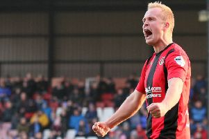 Crusaders' Jordan Owens celebrating on Saturday against Glenavon. Pic by Pacemaker.
