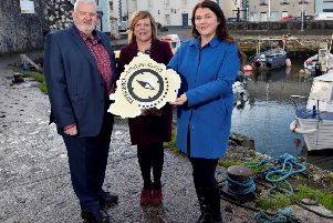 Bill Adamson, chairman and, Kelli Bagchus, manager, both Carrickfergus Enterprise, with Portia Woods, founder of Toast the Coast.
