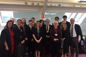 Joan Salters MBE pictured with staff and students at Ballyclare High.