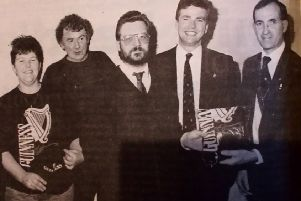 William Stewart (right) chairman of the Carrickfergus Round Table presenting the White Cliff Inn team with their prizes on finishing  runners-up in the Round Table/ Guinness Pub Quiz. 1991.