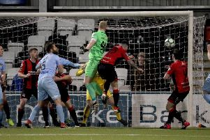 Warrenpoint's Aaron McCarey goes close to scoring  against Crusaders in the 3-1 loss