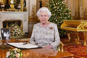 Queen Elizabeth II after she recorded her annual Christmas Day message, in the White Drawing Room of Buckingham Palace in central London.: John Stillwell/PA Wire