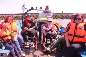 Staff and students of Mitchell House enjoying a day on the water at Belfast Lough Sailability.