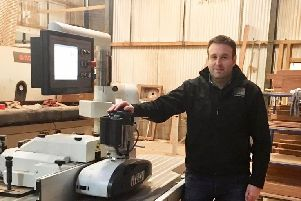 Colin Millar (Millar Woodcraft Specialist Joinery Manufacture Ltd) beside one of the machines funded with assistance from the Rural Development Programme.