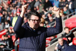 Hatters boss Mick Harford applauds the visiting fans at Fleetwood