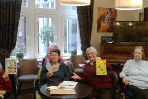 Residents at Gracewells Care Home in Maids Moreton with the cards sent to them by members of Water Babies