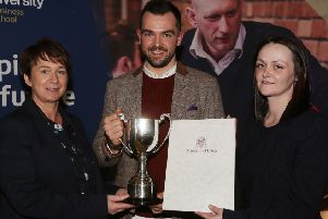 Thomas Sinton is presented with his award by Ciara McKinless, HR Manager and Olga Henry, general manager from sponsors Da Vinci's Hotel.