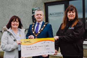Mayor of Antrim and Newtownabbey, Councillor Paul Michael and Kirstie Cameron, owner of Glendale Tree Services present a cheque for �600 to Claire Hogarthy, Fundraising Manager with Friends of the Cancer Centre.