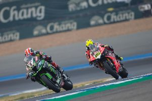 World Superbike champion Jonathan Rea is chased by Alvaro Bautista at the Chang International Circuit in Thailand.