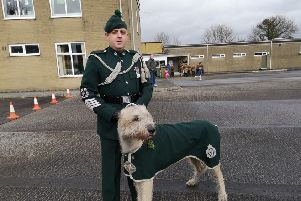 Royal Irish Regiment mascot Brian Boru X and his handler Wolfhound Major Moore.