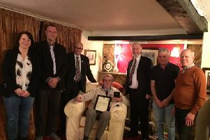 Bo Patrick pictured receiving his 50-year service award from the Football Association in recognition of his work at Burton Park Wanderers in 2017