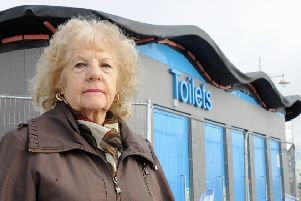 Cllr Jeanette Warr outside the closed toilets earlier this year. She said the promenade needed temporary toilets now