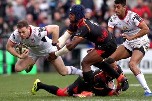 Ulster's Darren Cave is tackled by Meli Rokoua and Bjorn Basson of Southern Kings